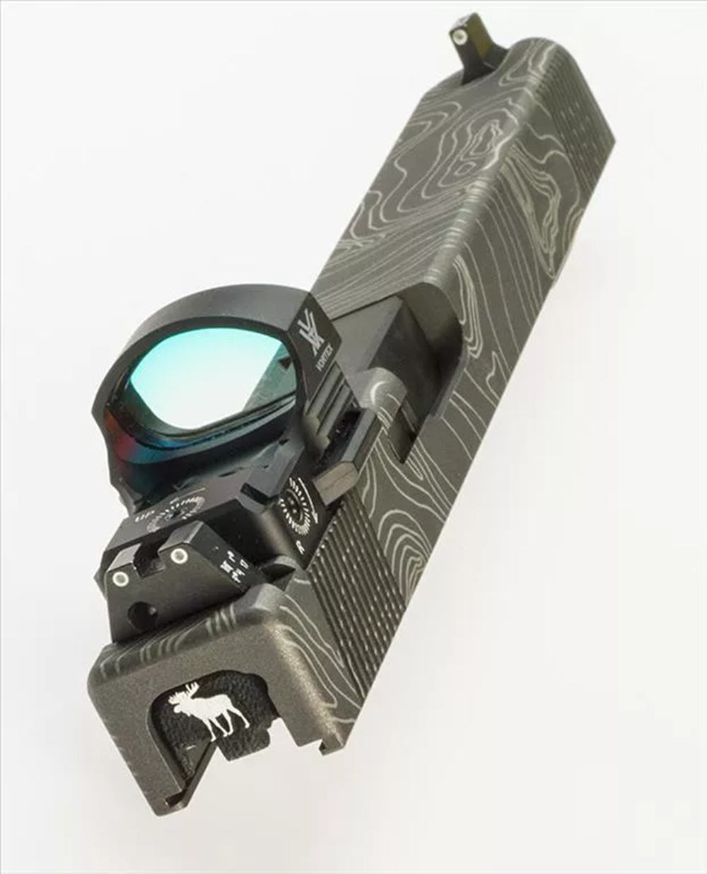 Combat Cut for Vortex Viper, with Trijicon Suppressor Height sights (*NOT recommended, due to insufficient height for co-witness). *Also featured: Tungsten Cerakote, Topographical laser engraving and custom 3-D engraved slide cover plate.